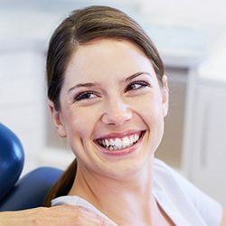 Woman in dental chair with healthy smile
