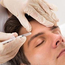 Closeup of man receiving Botox Therapeutic injection