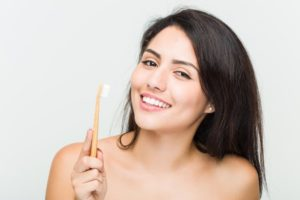 woman using eco-friendly oral hygiene products